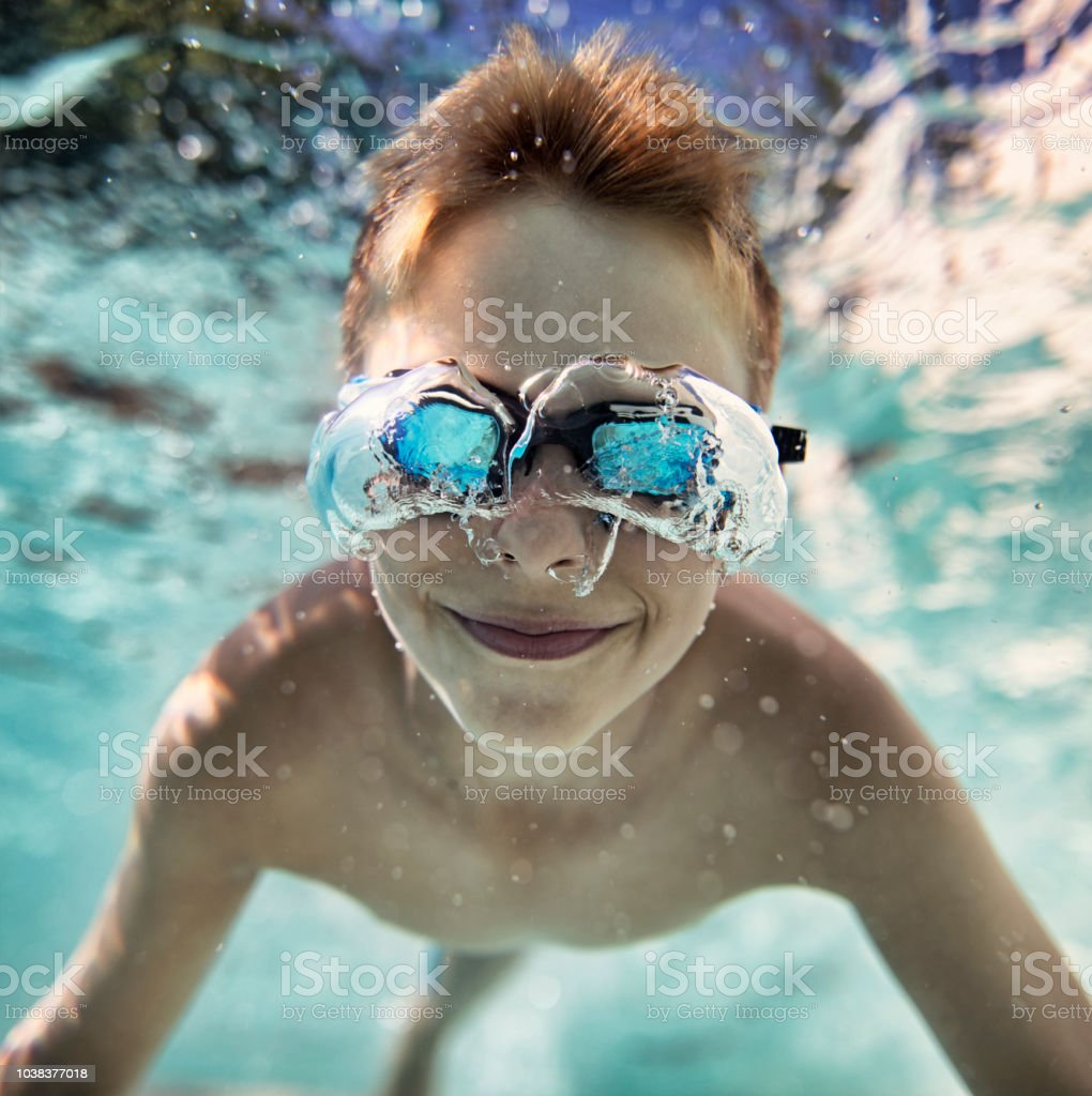 Little Boy Swimming Underwater In Pool Stock Photo ...
