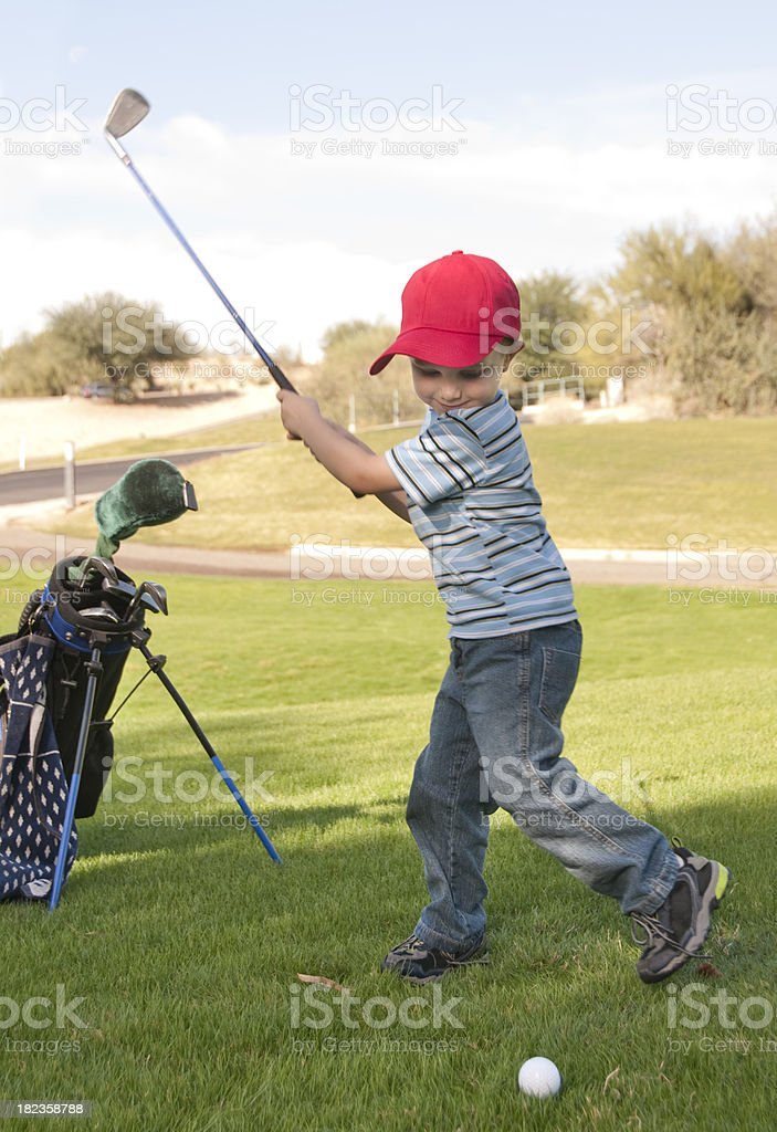 Little Boy Swinging Golf Club royalty-free stock photo