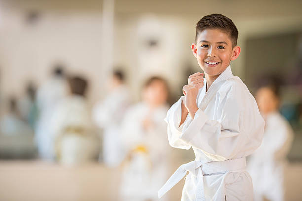 little boy taking karate - karate stock photos and pictures