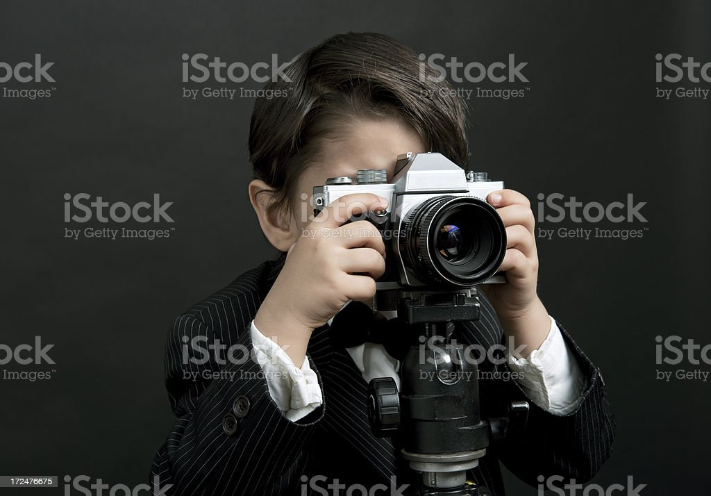 Little boy taking pictures royalty-free stock photo