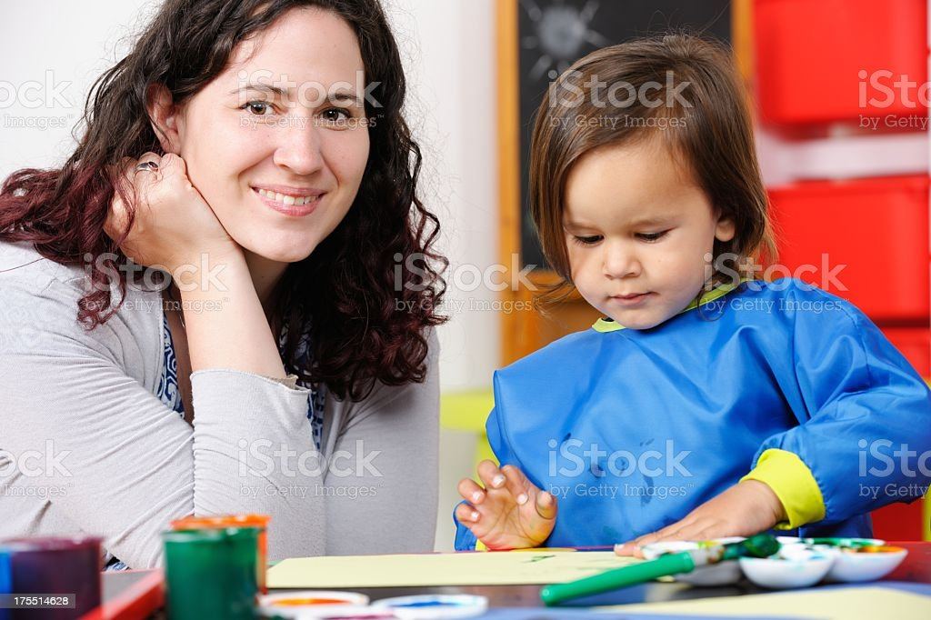 Little Boy/ Toddler Enjoying Finger Painting With Carer/ Parent royalty-free stock photo
