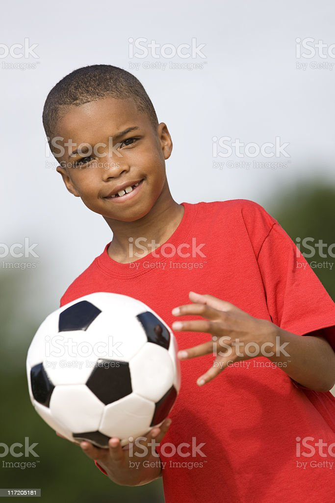 Little Boy Tossing A Soccer Ball royalty-free stock photo