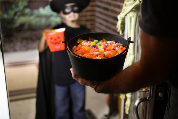 Little boy trick or treating on Halloween. stock photo