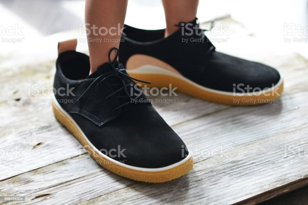 Little boy trying his father  oversize shoes stock photo