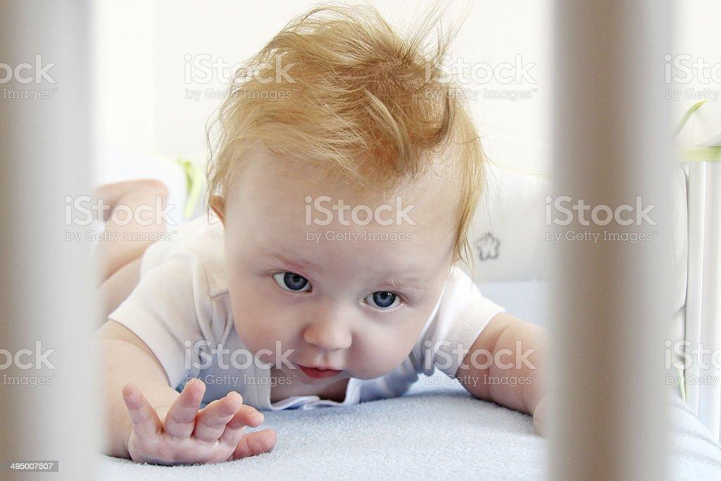 Little boy trying raise his head. stock photo