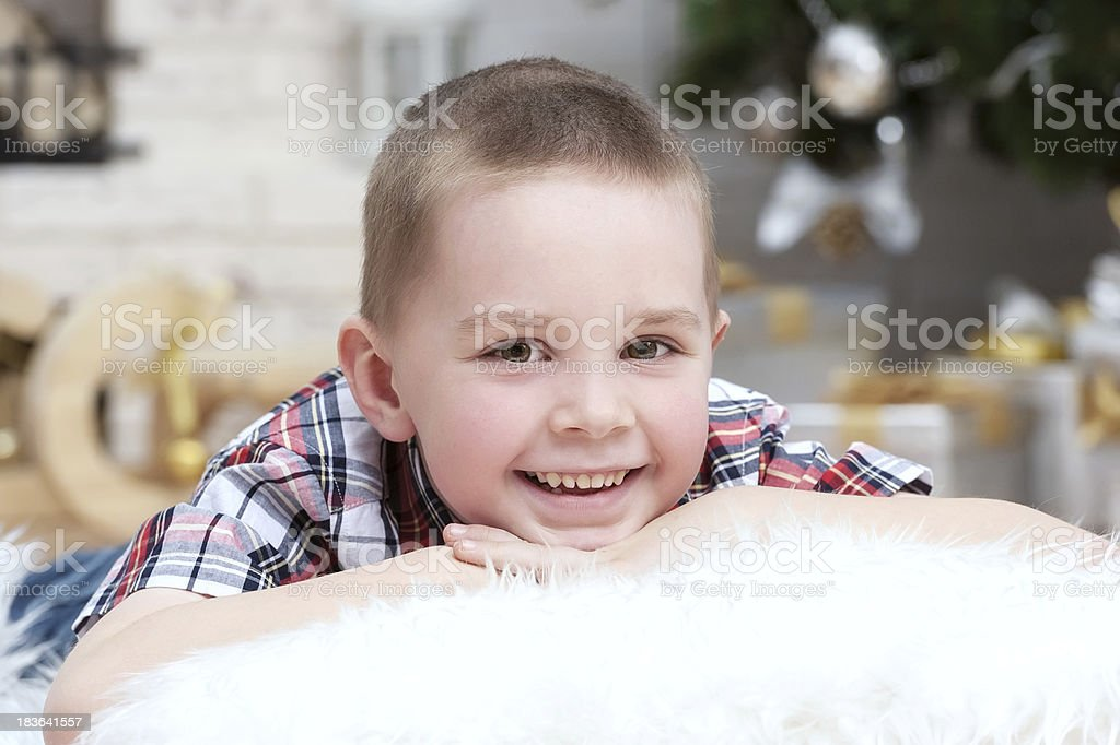 Little boy under the Christmas tree royalty-free stock photo