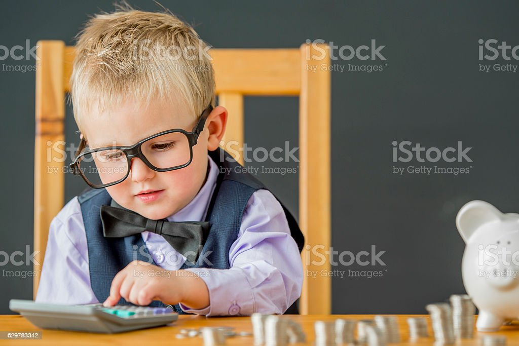 Little Boy Using a Calculator stock photo