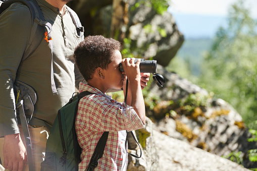 Little boy using binoculars