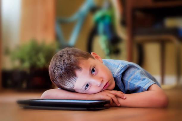 Little boy using digital tablet. stock photo