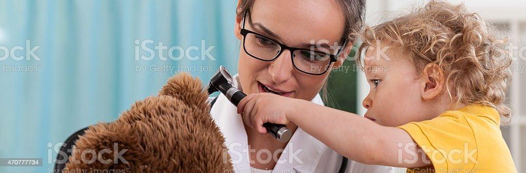 Little boy using otoscope stock photo