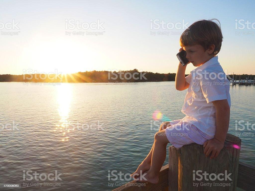 Little Boy Using Smart Phone stock photo