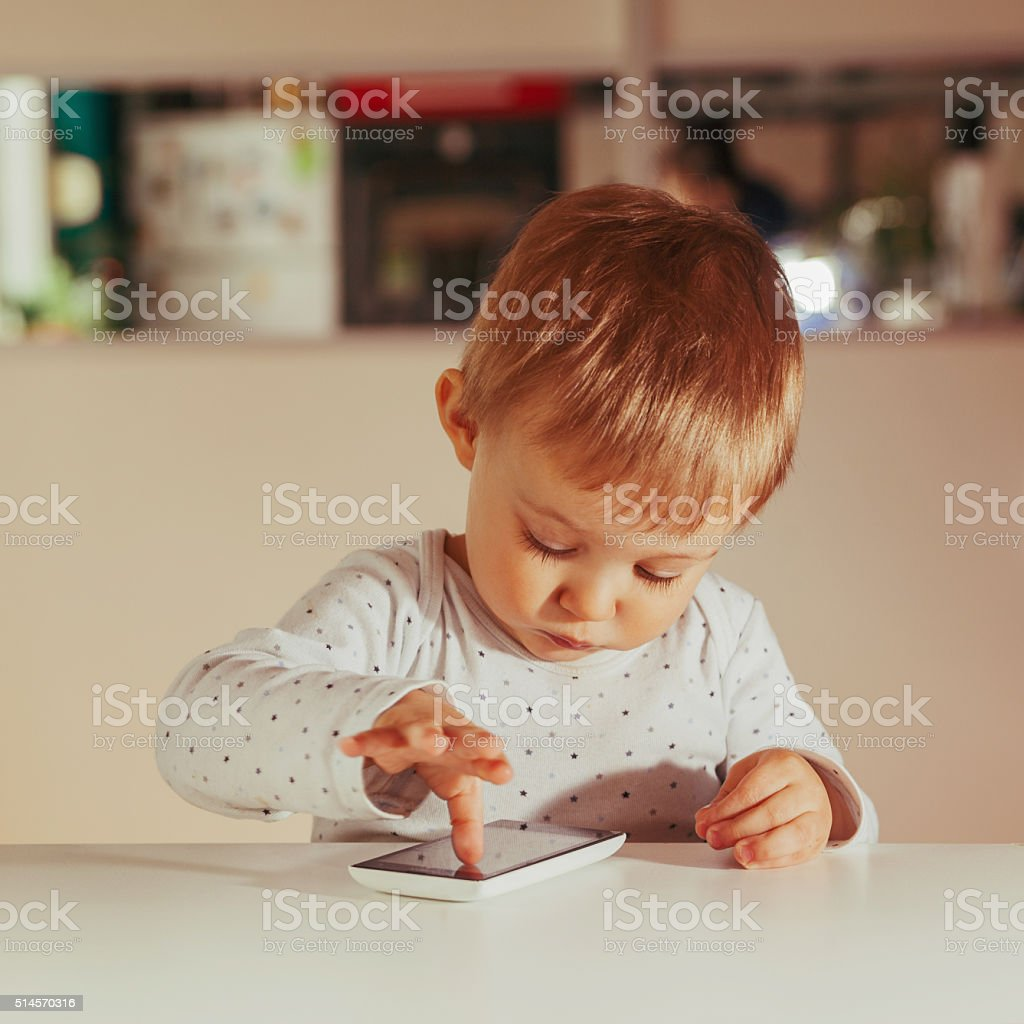 Little Boy Using Technology stock photo