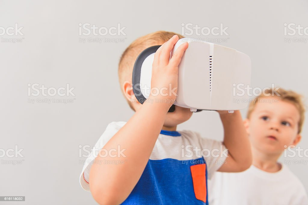 Little boy using virtual reality device in studio stock photo