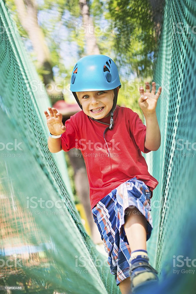 Little boy walking in amusement park. royalty-free stock photo