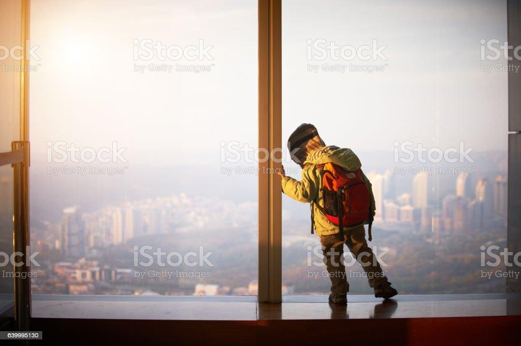 little boy walking on a observation deck stock photo