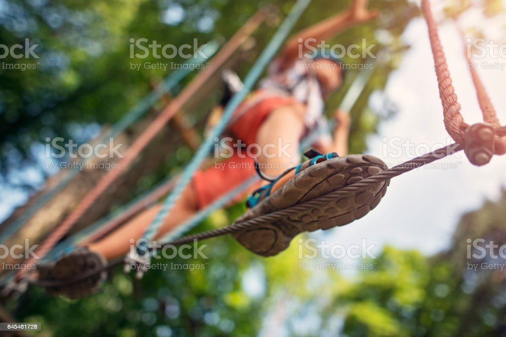 Little boy walking on line during ropes course stock photo