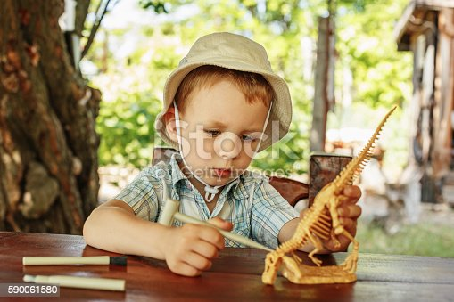 istock little boy wants to be an archaeologist 590061580