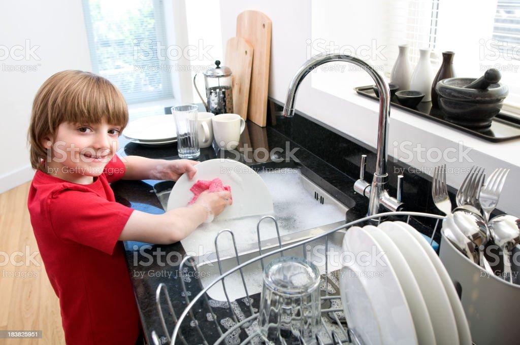 Little Boy Washing Up stock photo