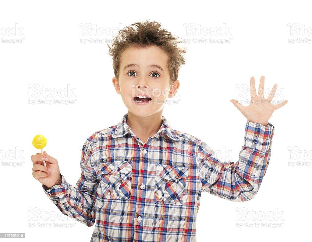 Kleine Junge wave goodye mit lollypop in der hand – Foto