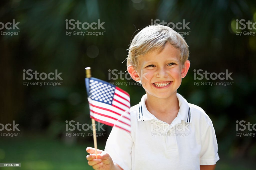 Little boy waving mini American flag royalty-free stock photo