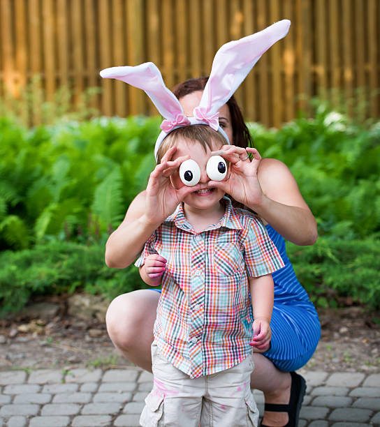 Little Boy Wearing Bunny Ears and Silly Egg Eyes stock photo
