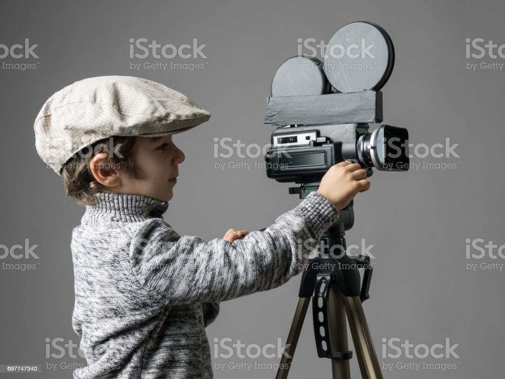 Little Boy Wearing Flat Cap Posing With Home Modified Video Camera stock photo