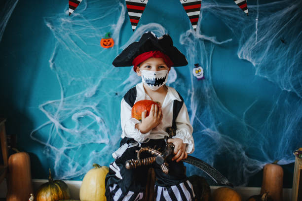 Little boy wearing Halloween costume and protective face mask during Covid-19 pandemic Little boy wearing Halloween costume and protective face mask during Covid-19 pandemic halloween covid stock pictures, royalty-free photos & images
