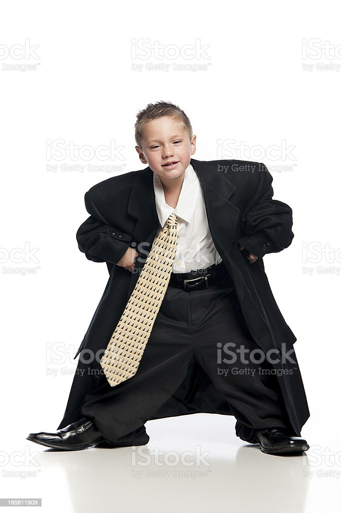 Little Boy Wearing Oversized Black Suit stock photo
