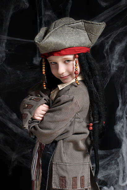 Little boy wearing pirate costume stock photo