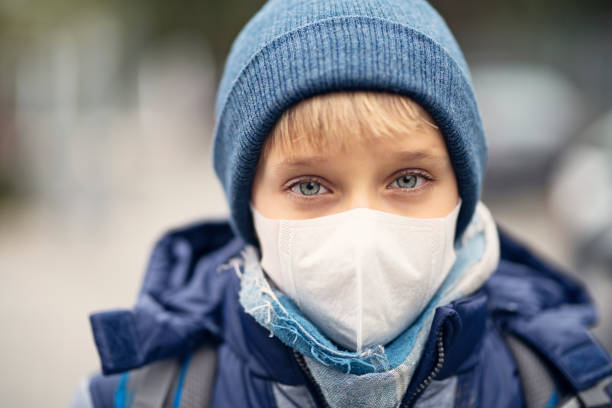 Little boy wearing pollution mask going to school Portrait of a little boy wearing pollution mask.  Nikon pollution mask stock pictures, royalty-free photos & images