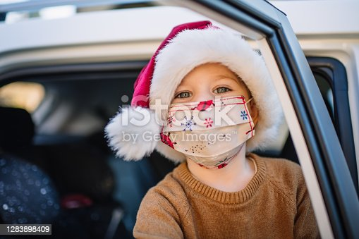 Child during COVID-19 pandemic on Christmas holidays in warm climate
