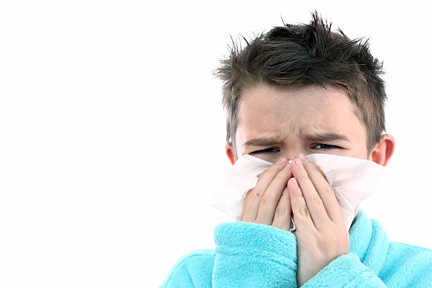 Little Boy With a Bad Cold, White background stock photo