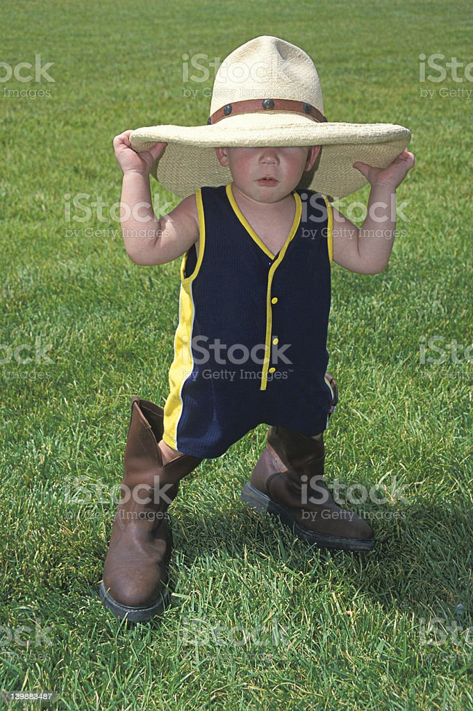 Little Boy with a Big Hat & Boots royalty-free stock photo