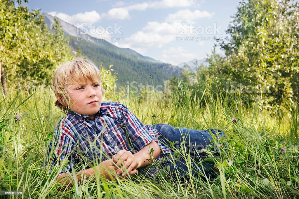 Little boy with a far away look stock photo