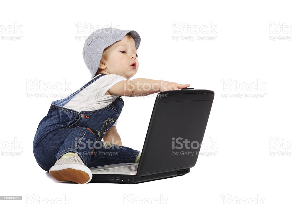 Little boy with a laptop royalty-free stock photo