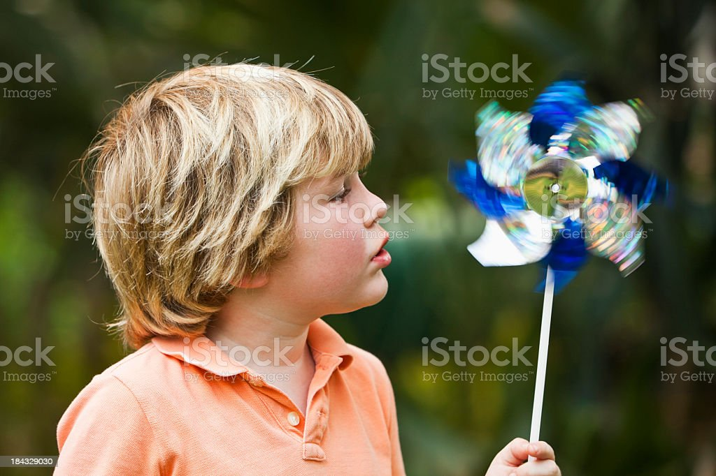 Little boy with a pinwheel stock photo