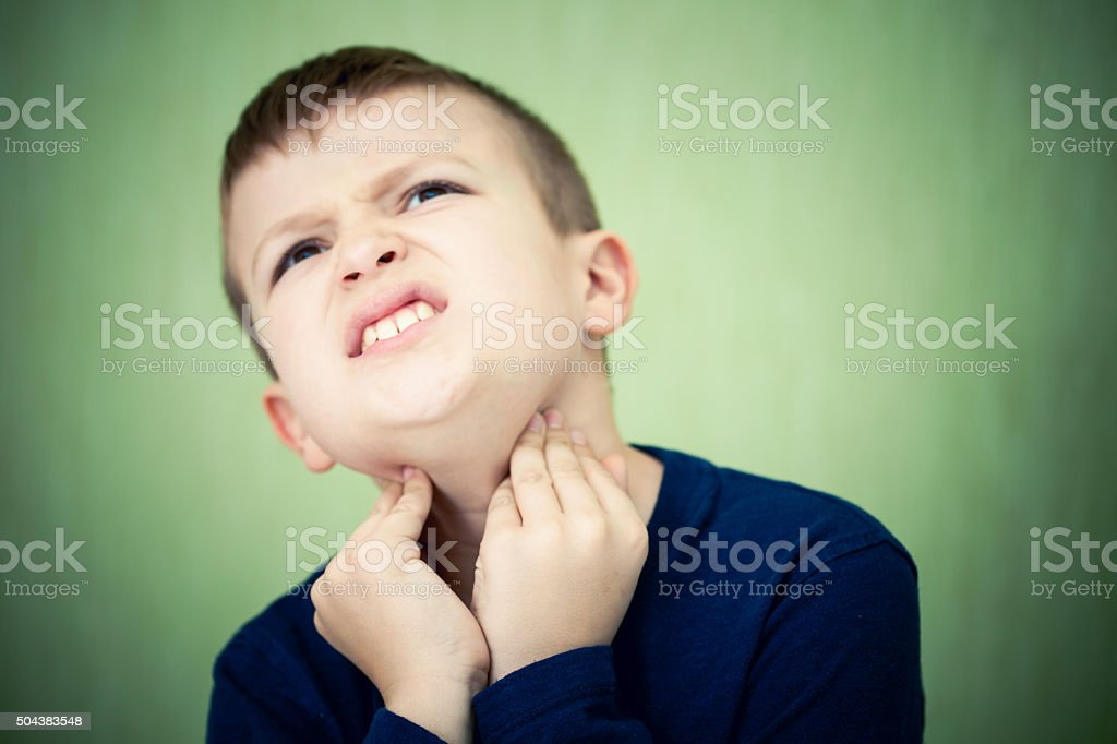 Little boy with a sore throat stock photo