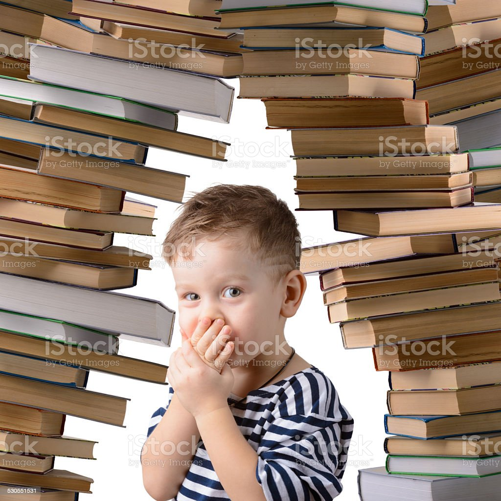 little boy with a stack of books stock photo