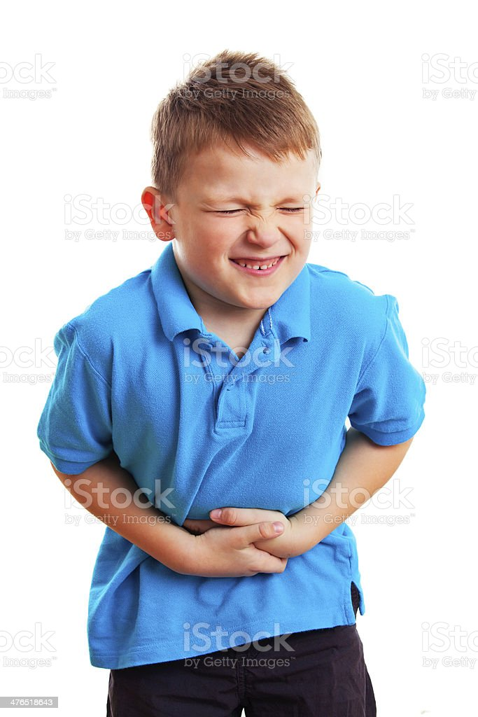 Little boy with a stomach ache stock photo