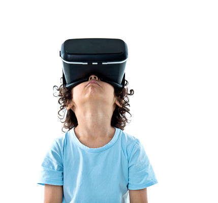 Little boy with a virtual reality game