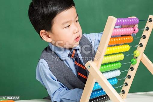 istock Little boy with abacus 621933558