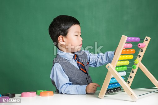 istock Little boy with abacus 621933642