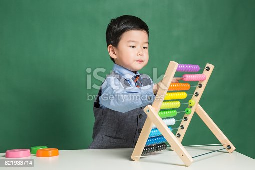 istock Little boy with abacus 621933714