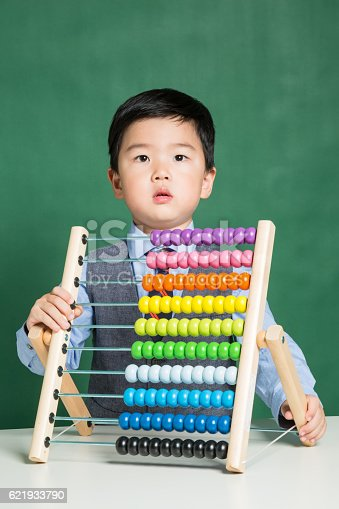 157230867istockphoto Little boy with abacus 621933790