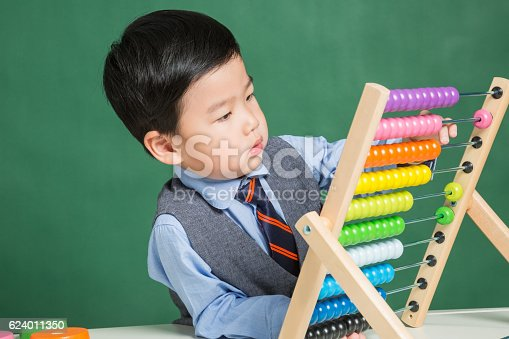 istock Little boy with abacus 624011350