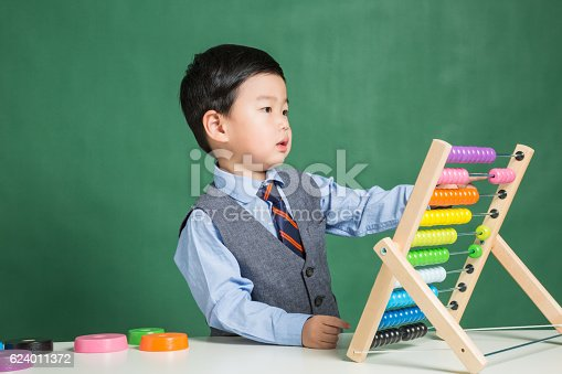 157230867istockphoto Little boy with abacus 624011372