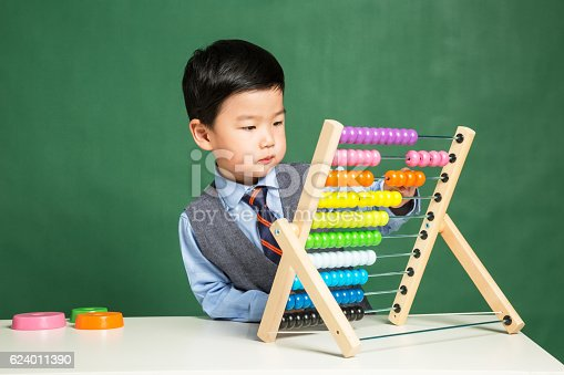 istock Little boy with abacus 624011390