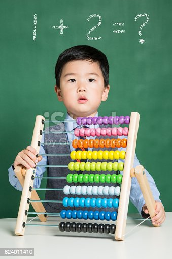 istock Little boy with abacus 624011410