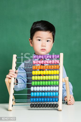 istock Little boy with abacus 624011422