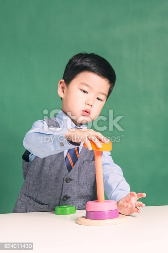 istock Little boy with abacus 624011430